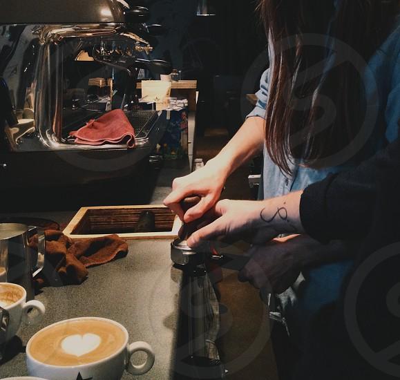 teamwork help coffee espresso espresso machine training. photo