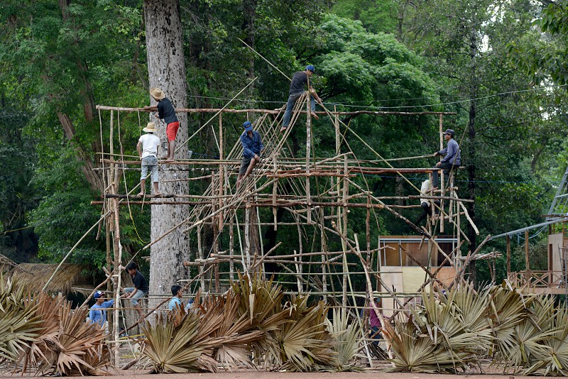 workers are building bamboo and wood houses in the Temple City of Angkor near the City of Siem Reap in the west of Cambodia.   Cambodia Siem Reap April 2014 photo