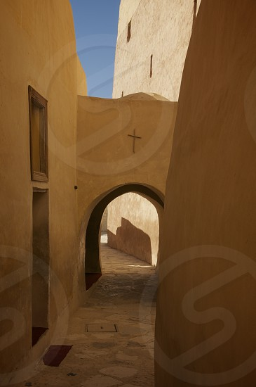 Passageway within the Monastery of St. Anthony near Hurghada Egypt. monasticism christianity arch archway adobe desert yellow beauty photo