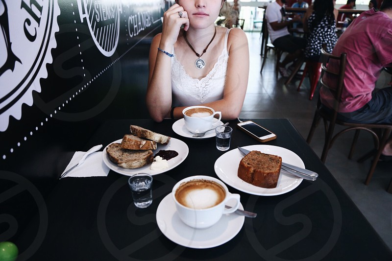 woman sitting near table photo