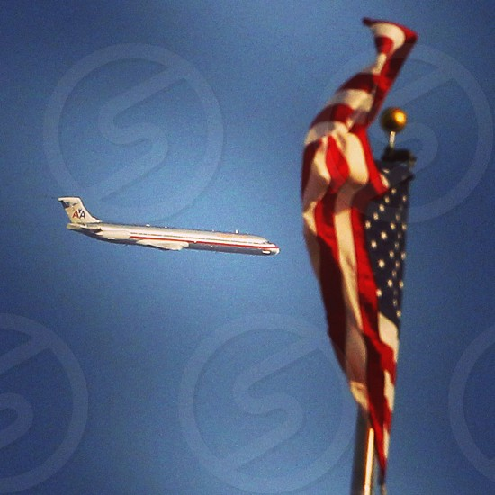 Airplane photographed with American flag. photo
