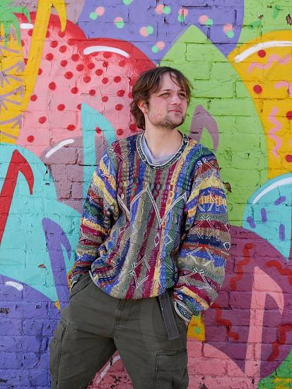 Colorful rainbow portrait sweater and street art photo