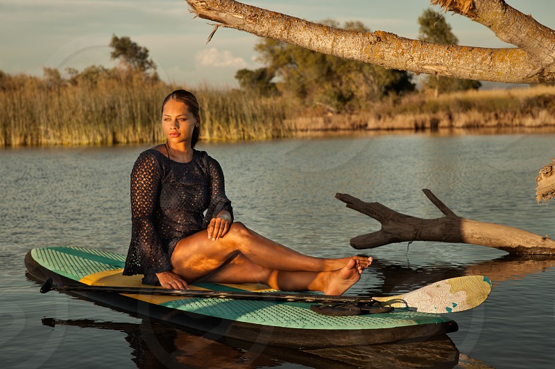 paddle board water sports young woman resting relaxing outdoors lake vacation paddle female 18-25 lifestyle summer recreation photo