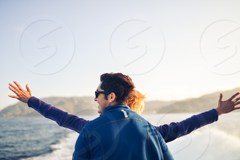couple on cruise ship looking out to sea photo