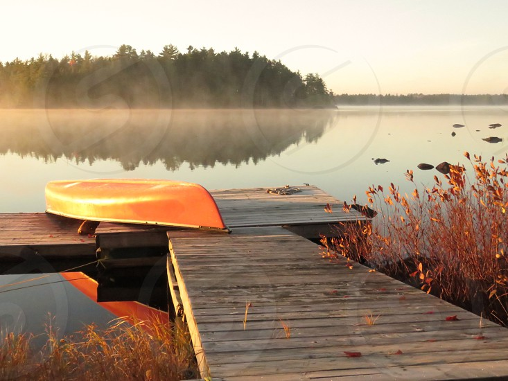 morning routine dawn paddle misty lake trees water reflections fall red canoe dock photo