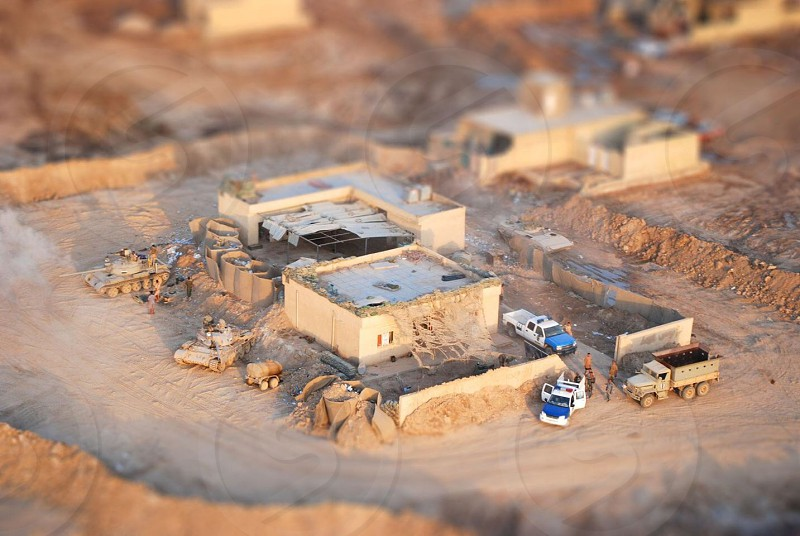 "Iraqi soldiers at a checkpoint. Viewed from a Blackhawk helicopter and ""tilt-shifted"" they look like the  toy soldiers I used to play with as a kid. 2007.  photo"