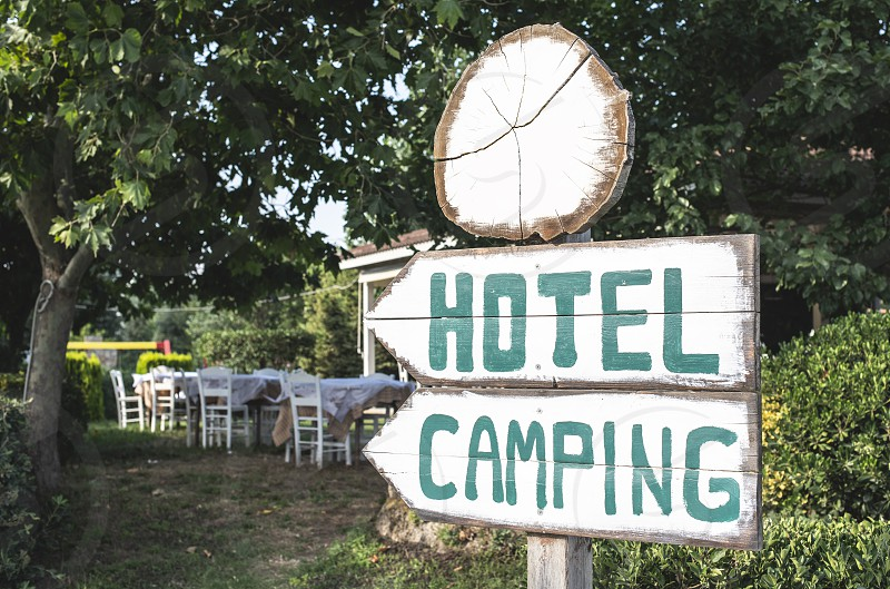 Hotel camping wooden signboard photo