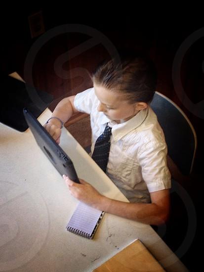 boy's white polo shirt  photo