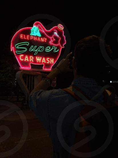 man taking a picture in elephant super car wash photo