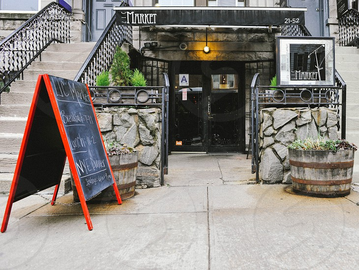 market nyc restaurant front with chalkboard sign photo