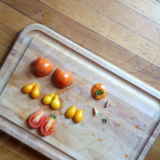 chopped tomatoes on wooden chopping board photo