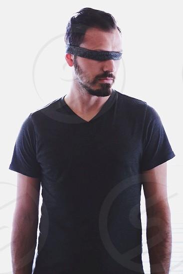 man in black v neck t shirt photo