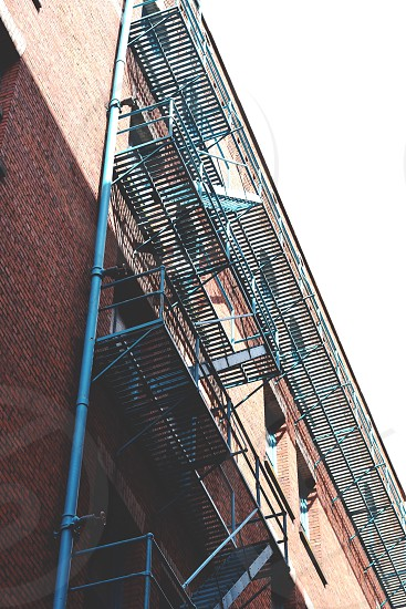 emergency fire exit staircases outside brick building photo