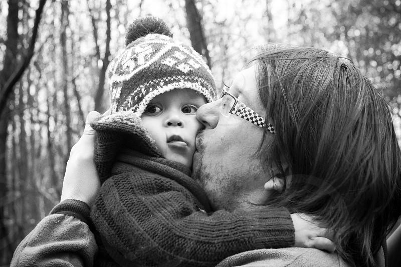 human kissing a baby photo