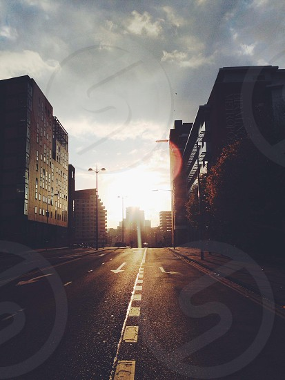 In the city roads cross in a sunset lot street  photo