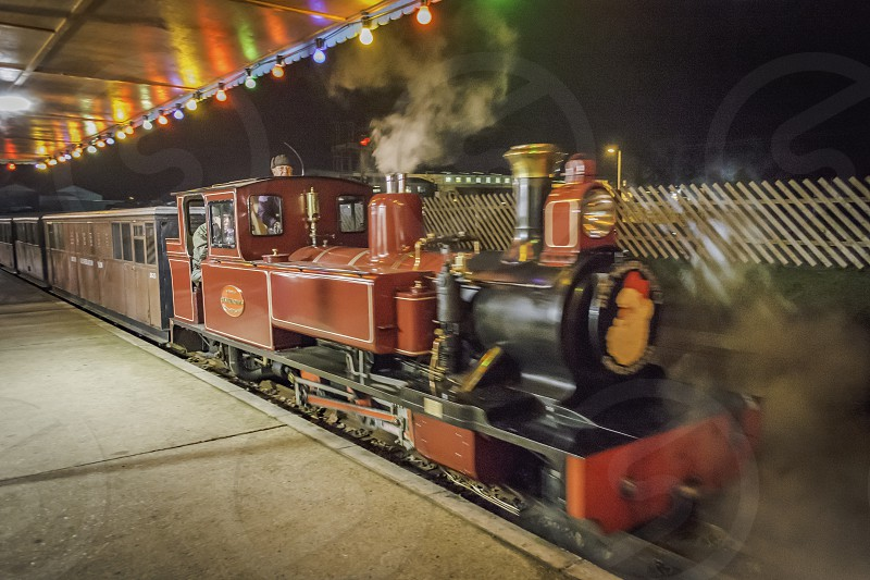 This miniature steam train has an interesting motion blur at the front as it arrives at the station Bure Valley Railway photo