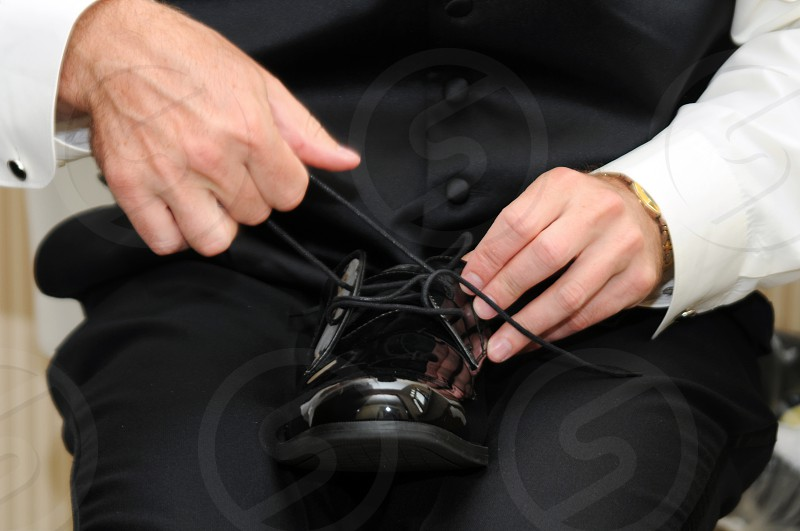 Close up of hands tying shoelaces photo