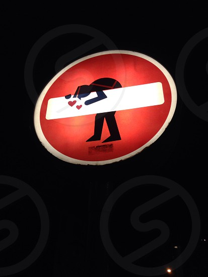 red man and heart print sign photo