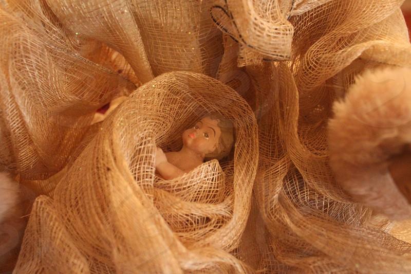 baby boy figurine in brown net photo
