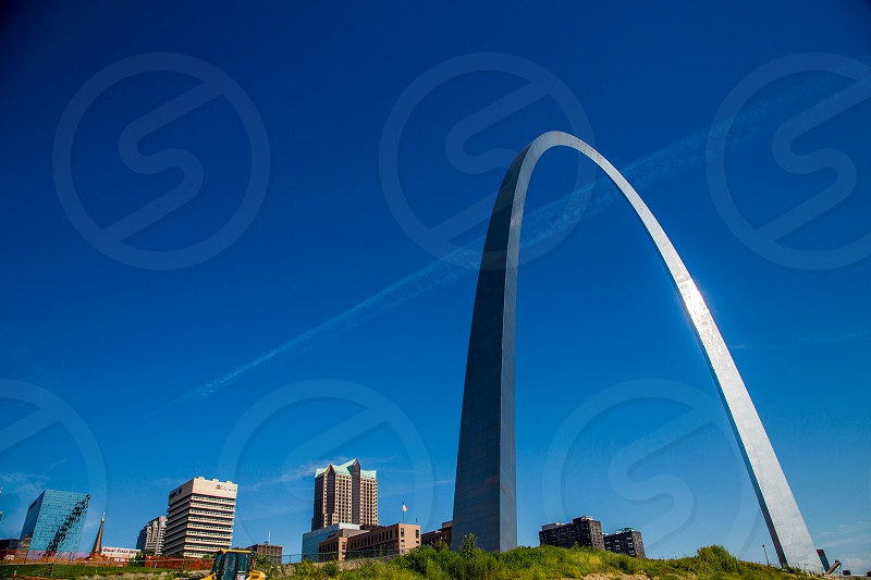 Exterior shot of the St. Louis Arch during the day. photo