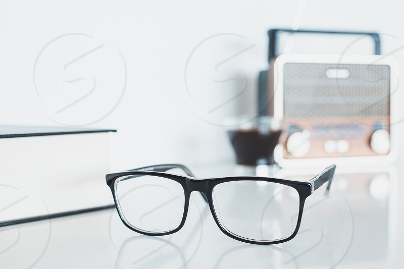 Glasses with radio book and coffee photo