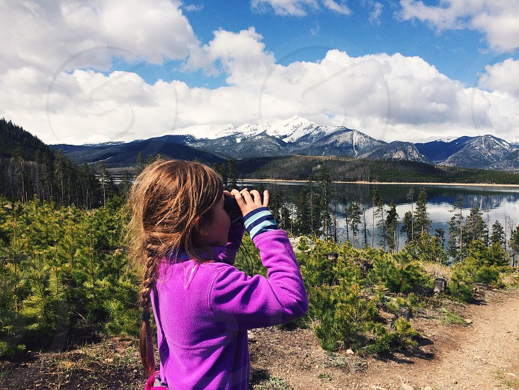 Little girl child binoculars curious cute kid outdoors play adventure fun camp camping summer camp mountains lake nature  photo
