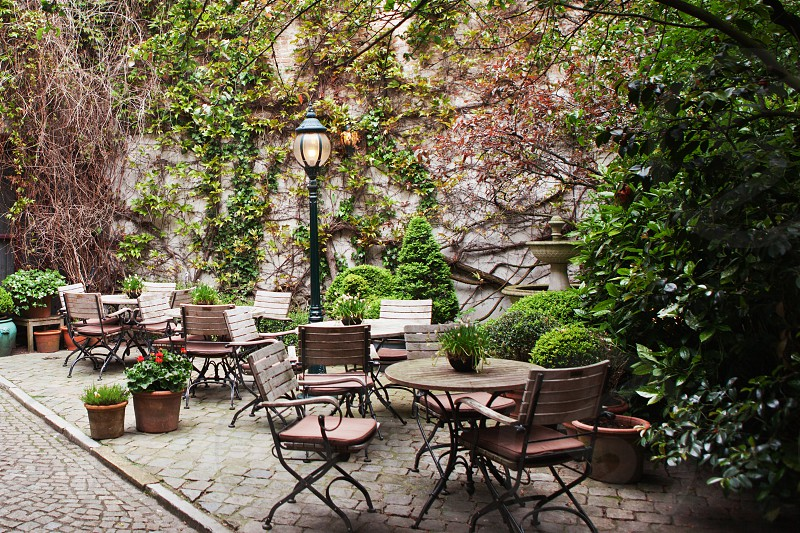Restaurants set up their dining tables outside in Bruges Belgium photo