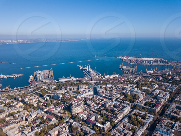 Beautiful panoramic view of the sea with the maritime station and part of the city of Odessa on a summer day. Aerial view from the drone photo