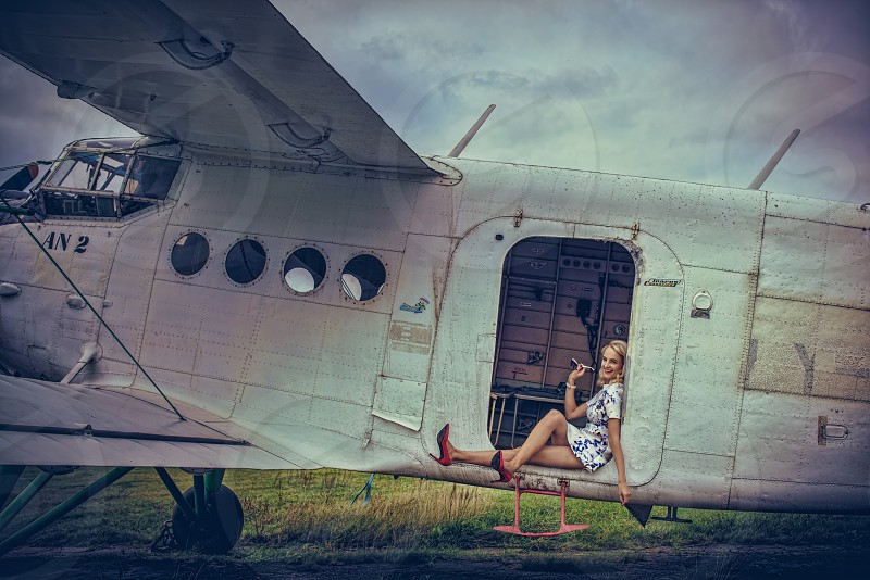 Stewardess of the very old plane photo