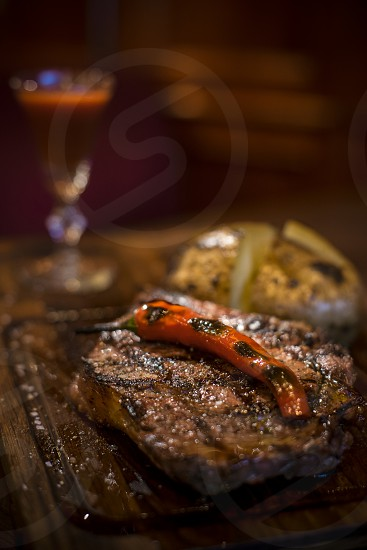 Veal steak with hot pepper photo