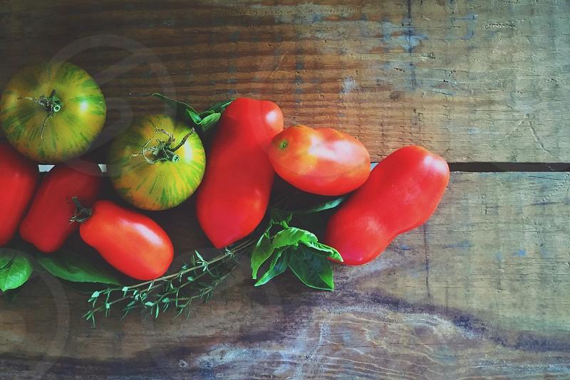 orange tomatoes beside green round tomatoes photo