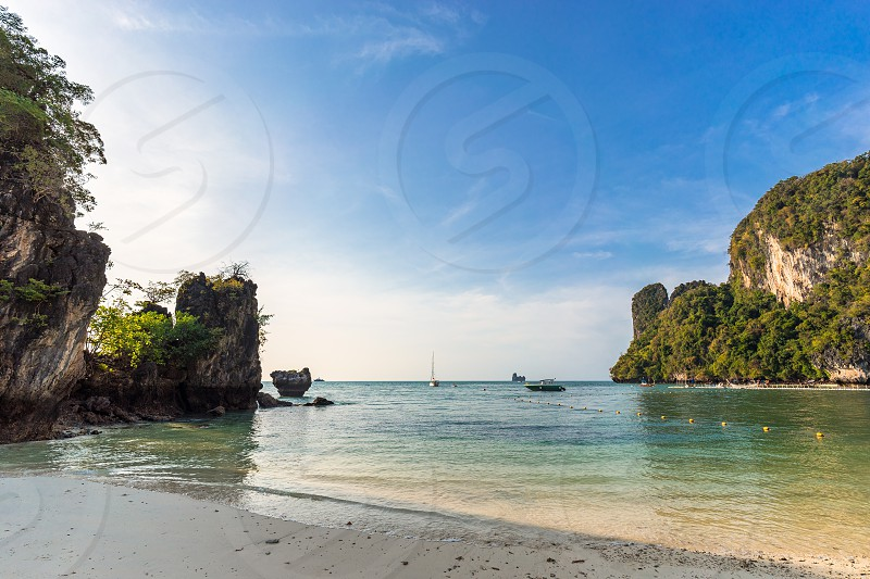 Seascape of beautiful empty tropical beach and lagoon with clear water on Koh Hong Island in Thailand photo