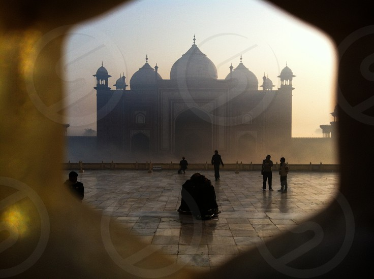 Couple in front of the Mosque in Agra India photo