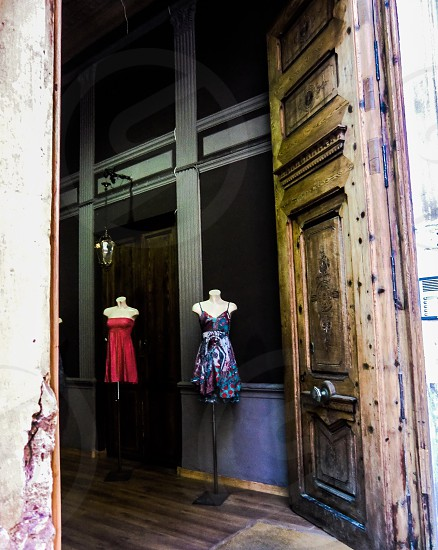 Fashion fashions dress dresses store  shop shopping door wooden city  cityview commercial  architecture  wooden wood Valencia Spain fabric  materials  fancy material  female  woman's women's  doll dolls torso torsos exhibit open entre  enter  photo