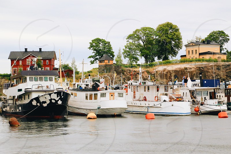 Harbor seaside sailing ship  sailing boat water transportation  water transport  engine island sea water  photo