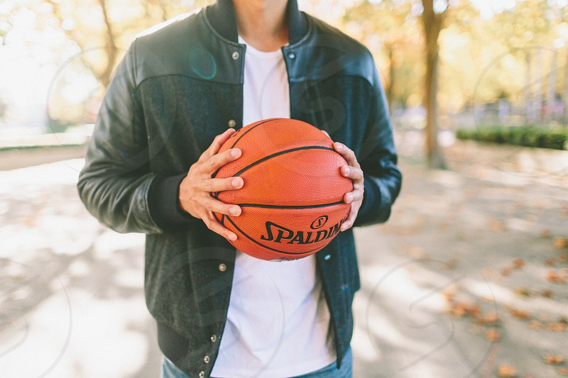 A young man playing basketball photo