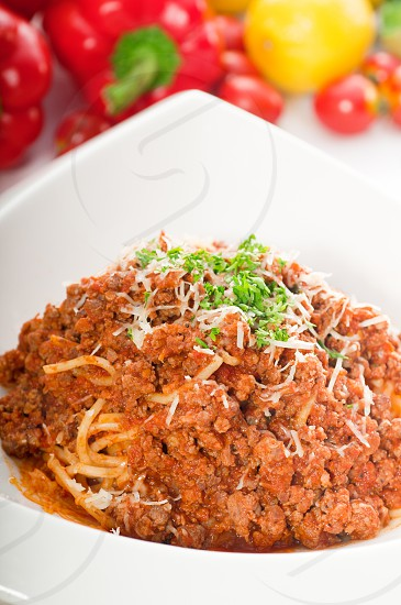 Italian classic  spaghetti with bolognese sauce and fresh vegetables on backgroundMORE DELICIOUS  FOOD ON PORTFOLIO photo
