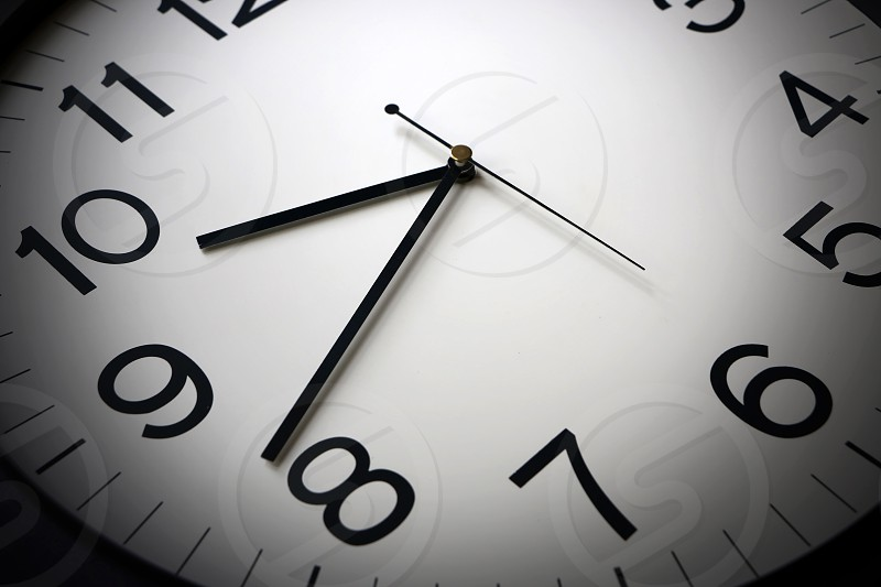 Modern clock face with moving hands photo