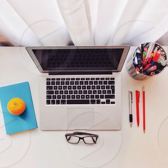 silver macbook air beside black rimmed eyeglasses photo