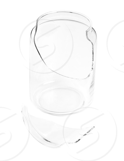 shattered glass jar isolated over white background photo