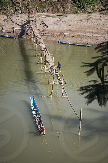 the construction of the Bamboo Bridge over the Nam Khan river in the town of Luang Prabang in the north of Laos in Southeastasia. photo
