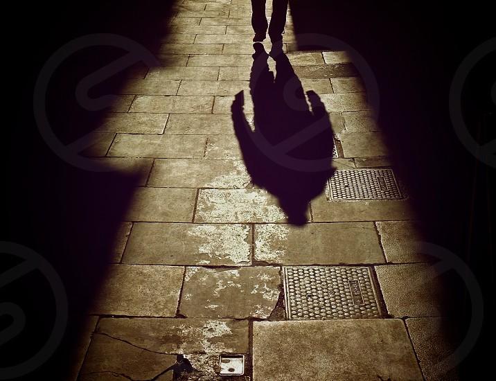 man walking in a tiled floor photo