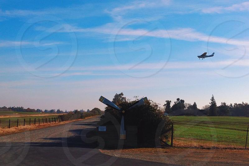 windmill on green plains photo