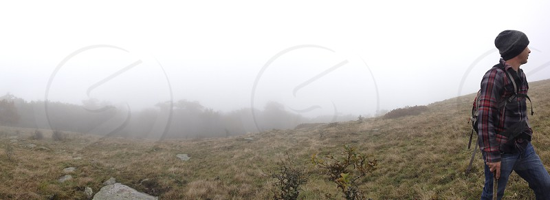 Male hiker in fog. photo