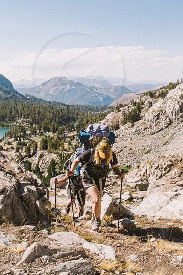 people doing trekking behind mountains photo
