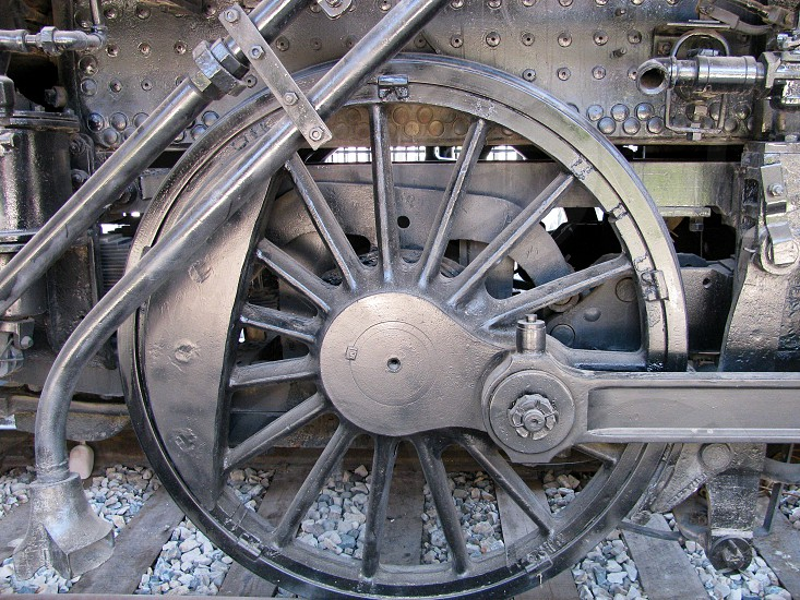 Massive wheel on a Mogul 2-6-0 railroad locomotive that was built in 1900 and logged over a million miles for the Southern Pacific Company.  photo