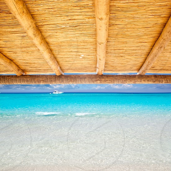 Cane sunroof with tropical perfect beach of truquoise water view photo
