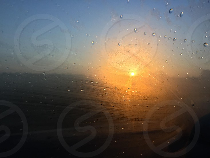 water droplets on clear glass window photo