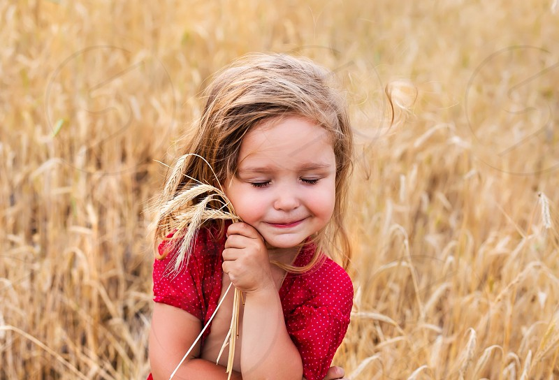 Cute girl at the field love wind emotions sweet angel joy happy little baby cute #girl #field #summer #beautiful  photo