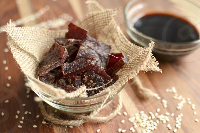 A Bowl of Beef Jerky with flavoring ingredients of sesame seeds and soy sauce photo